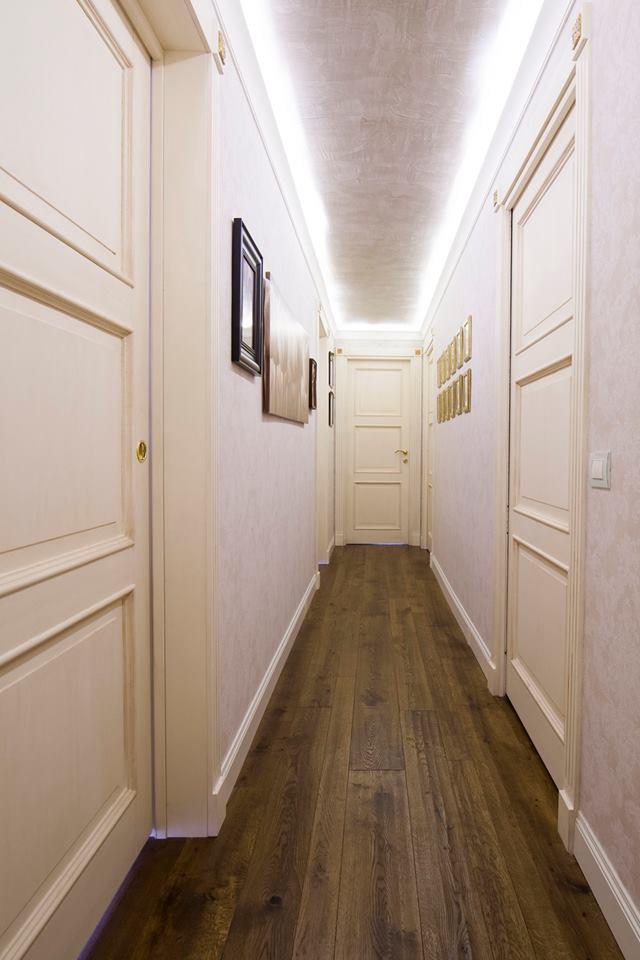 Arredare un 39 attico legnoeoltre for Arredare corridoio ingresso