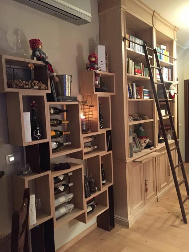 Vineria e libreria con inserti ferro